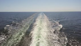 Footage of turquoise foamy sea waves behind rapid motor boat. Footage of turquoise foamy sea waves behind rapid motor boat stock footage