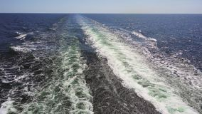 Footage of turquoise foamy sea waves behind rapid motor boat. Footage of turquoise foamy sea waves behind rapid motor boat stock video
