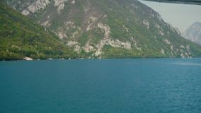View of the Hills and Lakes from the Boat. This is footage of View of the Hills and Lakes from the Boat stock footage