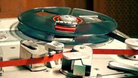 Vintage Audio recorder, fast spinning reel with stop and play stock footage