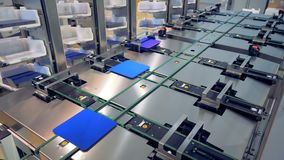 Footage of a working factory mechanism of solar cells distribution - Innovation technology concept. Footage of a working factory mechanism of solar cells stock footage
