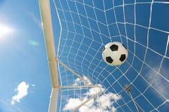 Footbal hit the goal net. Agains blue sky Stock Photography