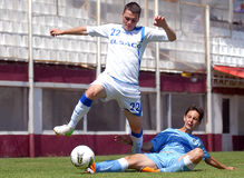Footbal players in action Stock Photo