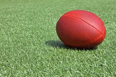 Football. Sitting on artificial turf, just waiting for the big game Stock Images