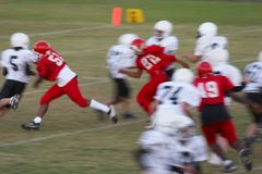 Football. Texas - Middle school kids playing football, motion blur Royalty Free Stock Photo