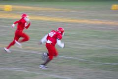 Football. Texas - Middle school kids playing football, motion blur Royalty Free Stock Image