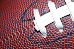 Football. Close up of an american football against a black background Royalty Free Stock Images