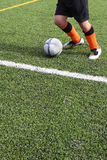 Football. Concept. Green grass and player on the field Royalty Free Stock Photography