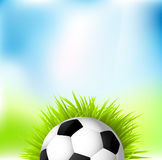 Football. On grass against green & blue background, vector Royalty Free Stock Photos