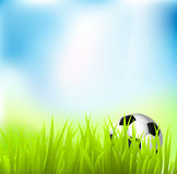 Football. On grass against green & blue background, vector Stock Photo