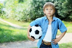 Football. Shot of a cute boy with a ball outdoor Stock Images