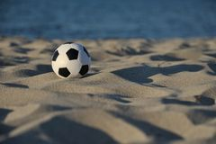 Football. A soccer on the beach Stock Images