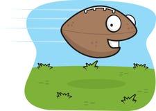 Football. A smiling football flying through the air Royalty Free Stock Photos