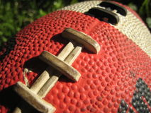 Football. Contrasting light on a football. Close up image Stock Image