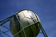 Football #2. A football in goal net Royalty Free Stock Image