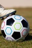 Football. A boot on a football Stock Photos