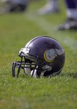 Football. Helmet placed on the playing field Royalty Free Stock Images