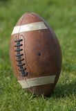 Football. Closeup of  standing upright on the playing field Stock Images
