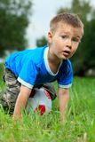 Football. Shot of a cute emotional boy with a ball outdoor Stock Image