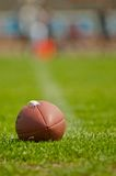 Football. Ball at stadium green grass Royalty Free Stock Image