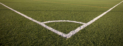 Football. Concept. Green grass and corner lines of a field Royalty Free Stock Photography