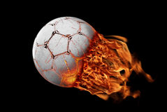 Football. Soccer ball in flames after a shoot Stock Photos