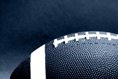 Football. Kinda edgy high contrast blue toned closeup of a football royalty free stock photography