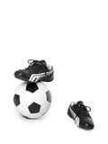 Football. Soccer ball and boots isolated on white background Royalty Free Stock Images