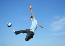 Football. Young boy playing football on a sky background Royalty Free Stock Images