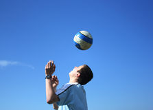 Football. Young boy playing football on a sky background Stock Photos
