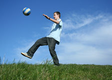 Football. Young boy playing football on grass Royalty Free Stock Photography