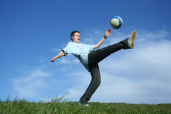 Football. Young boy playing football on grass Stock Photography