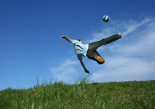 Football. Young boy playing football on grass Stock Image
