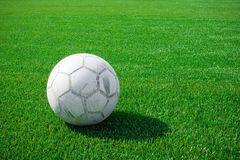 Football. The football lays on a green grass stock images