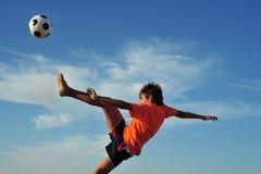 Football. Young boy playing football - low angle virw Stock Photos