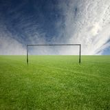 Football 8. Its a football pitch, with white clouds Royalty Free Stock Photo