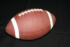 Football. Image of a football isolated on black background Stock Photography