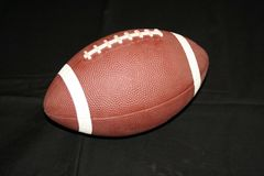 Football. Image of a football isolated on black background Stock Images