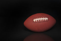 Football. On black background ready for your type Royalty Free Stock Photo
