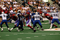 Football action. An American football action during an arena football game royalty free stock photo