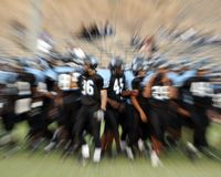 Football action. Intense action at a professional football game Stock Photography