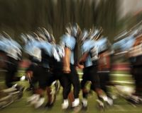 Football action. Intense action at a football game Royalty Free Stock Photography