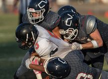Gang Tackles. Football action with Arcata vs. Central Valley High School in Northern California Stock Images