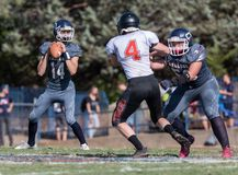 Pass Defense. Football action with Arcata vs. Central Valley High School in Northern California Stock Image