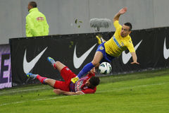 Football action - hard tackle Royalty Free Stock Photography