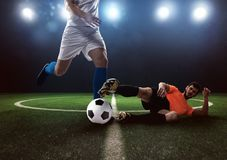Soccer conflict scene between players at the stadium Stock Photos