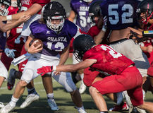Going in Low. Football action with Shasta High School vs. Foothill in Palo Cedro, California Stock Image