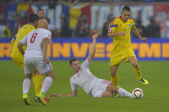 Football action - sliding tackle Stock Photos