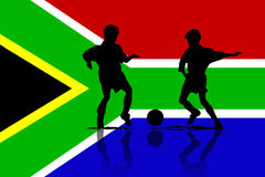 Football in Africa. An illustration with a silhouette of football players on an African flag Royalty Free Stock Images