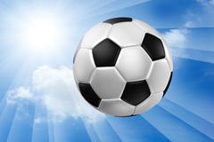 Football against blue sky . Royalty Free Stock Photos